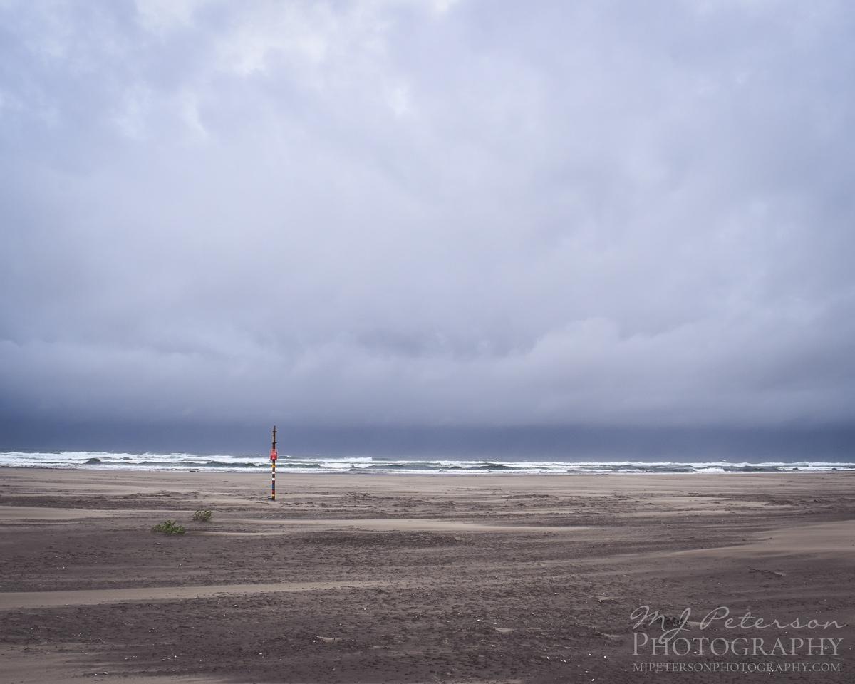 Warning Post by the Sea at Grayland Beach, Washington